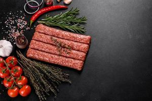 Fresh raw mince for grilled kebab with spices and herbs photo