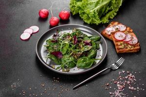 Fresh juicy salad with leaves of mangold, arugula, spinach and beets photo