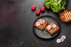 Delicious crisp sandwich with toast, radish, pumpkin seeds and flax seeds photo