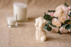 Beautiful candle in the shape of a human body photo