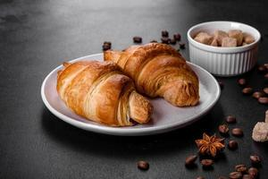 Fresh crisp delicious French croissant with a cup of fragrant coffee photo