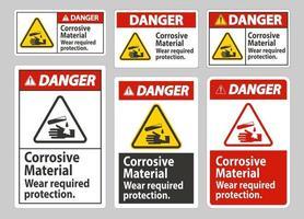 señal de peligro materiales corrosivos, use protección requerida vector