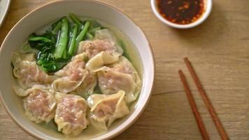 Pork wonton soup or pork dumplings soup with vegetable - Asian food style video