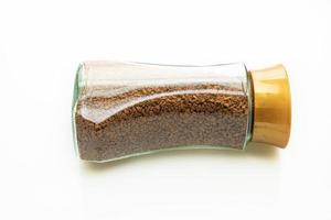 Instant coffee in glass bottle photo