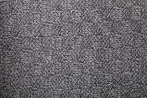 textura de bufanda gris tejida foto