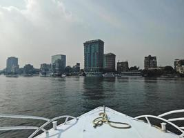 View from a boat. Big buildings on the coast of Nile river. Cairo city, Egypt photo