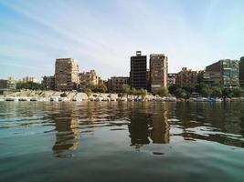 Big buildings on the coast of Nile river. Cairo city, Egypt photo