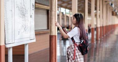Asain woman looking at the map photo