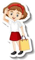 una plantilla de pegatina con una linda estudiante en uniforme escolar vector