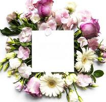 Pink flowers in frame with white square for text photo