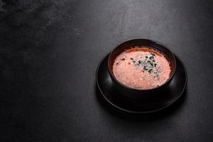 Tasty fresh spicy Malaysia soup tom yam with tomato photo