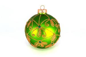 Green Christmas ball isolated on white background photo