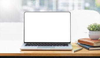 Blank screen laptop computer in modern office photo