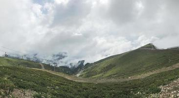 Caucasus mountains wrapped in clouds at Roza Khutor, Russia photo