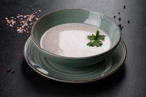 Delicious fresh hot mushroom soup in a ceramic plate. photo
