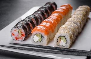 Japanese food with avocado, shrimp, crab and salmon photo
