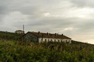 Landscape with old abandoned houses. photo