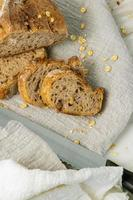 Delicious fresh baked bread on marble background. Healthy diet lifestyle. photo