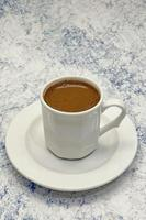 traditional turkish coffee in a white cup photo