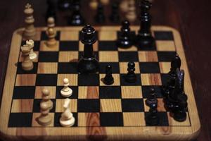 Wooden chessboard with checkers photo