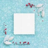 Christmas card or banner White pine cones and red berries photo