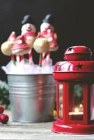 Decorated cake pops on dark background with colorful bokeh background photo