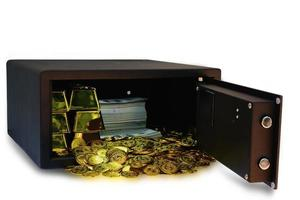 Steel safes box full of coins stack and gold bar and banknote 100 USD at the white background with clipping path photo