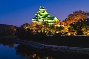 Okayama Castle, aka Ujo or Crow castle, by river Asahi in Japan photo