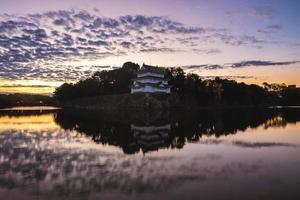 Northwest Turret and moat of Nagoya Castle in Nagoya, Japan at dawn photo