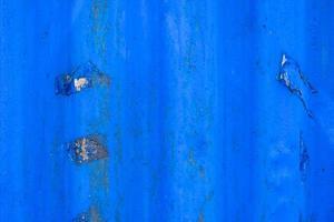 Blue peeling metal wall texture photo