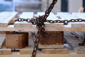 Old rusty and weathered iron chain photo