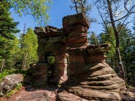 Stone gate, mysterious structure in the Vosges Mountains, France photo