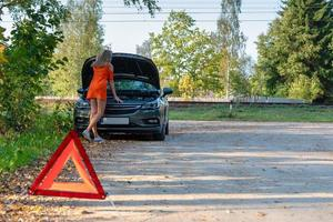 Car trouble, Women are stressed with broken car, about broken car photo