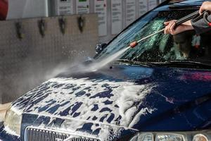 Car without touch washing self-service. Wash with water and foam. photo