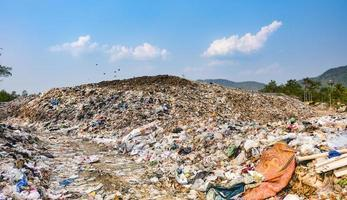 Polluted mountain large garbage pile and pollution photo