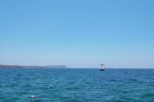 The coast of the Mediterranean Sea. The waves. The horizon. Sky and sea in summer photo