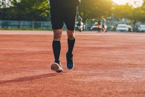 Runner Man jogging or running in evening at sunlight photo