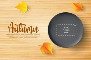 autumn background with realistic black plate over wooden board. vector