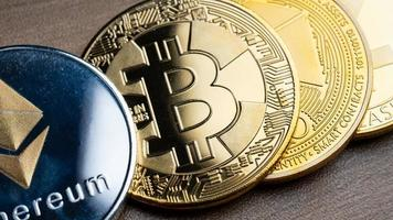 Business silver and gold bitcoin on wood table photo