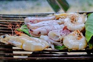 Fresh seafoods are traditionally roasted by wrapped banana leaves. photo