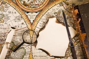 Magnifying glass and map on desk photo