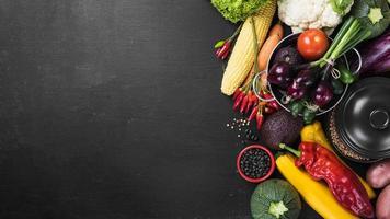 Vegetable harvest on dark background photo