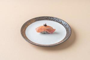 Smoked salmon raw on sushi rice - Japanese food style photo
