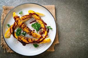 Grilled and barbecue corn with BBQ sauce photo