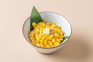 Steamed sweet buttered corn in bowl photo