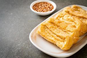Fried tofu with sauce - vegan and vegetarian food style photo