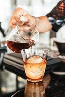 Cold drip Arabica black coffee in glass with ice ball photo