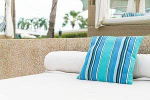 Comfortable pillow on pavilion near beach - travel and vacation concept photo