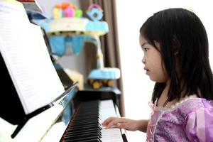Girl Playing Piano photo