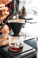 Pouring hot water for dripping Arabica coffee photo